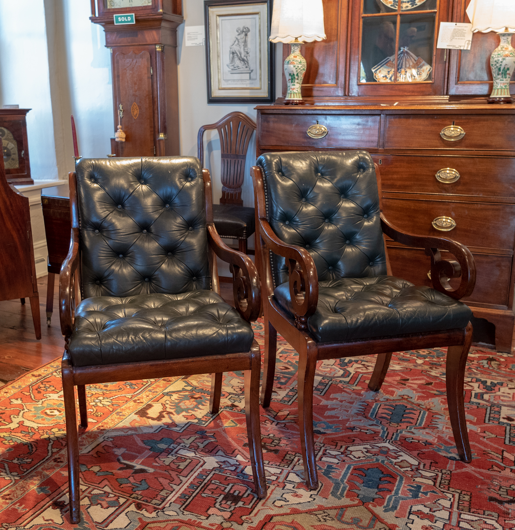 A Matched Pair Of Classical Mahogany And Leather Armchairs.