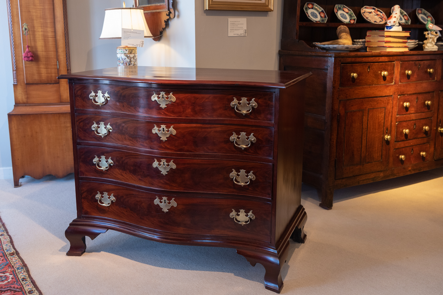 Chippendale Figured Mahogany Serpentine Chest Of Drawers