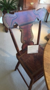 A Pair Of Painted Decorated Plank Seat Fiddle Back Side Chairs detail